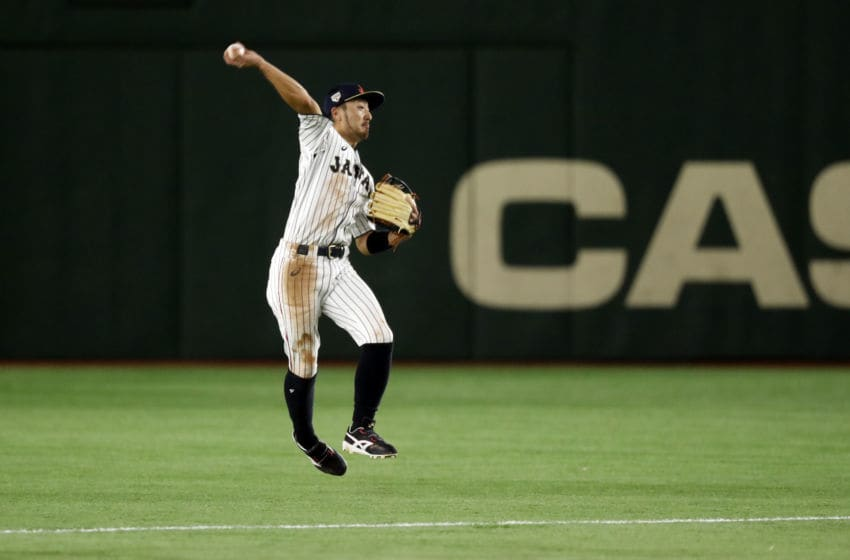 TOKYO, JAPAN - NOVEMBER 9: Ryosuke Kikuchi #4 of Team Japan throws to first base for the out during Game 1 of the Japan All-Star Series game against the MLB All-Stars at the Tokyo Dome on Friday, November 9, 2018 in Tokyo, Japan. (Photo by Yuki Taguchi/MLB via Getty Images)