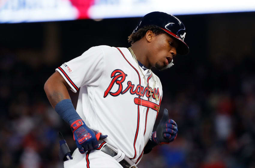 ATLANTA, GEORGIA - APRIL 01: Ronald Acuna Jr. #13 of the Atlanta Braves rounds third base after hitting a solo homer to lead off the third inning against the Chicago Cubs on April 01, 2019 in Atlanta, Georgia. (Photo by Kevin C. Cox/Getty Images)