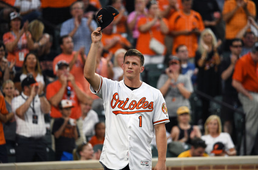 The Baltimore Orioles' first overall draft pick, Adley Rutschman, tips his cap to cheering fans as he is introduced during a game against the San Diego Padres at Oriole Park at Camden Yards in Baltimore on Tuesday, June 25, 2019. (Kenneth K. Lam/Baltimore Sun/Tribune News Service via Getty Images)