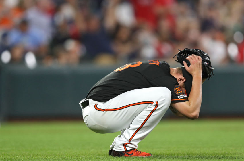 BALTIMORE, MARYLAND - JUNE 14: Pitcher Dan Straily #53 of the Baltimore Orioles reacts after allowing a two-run home run to Michael Chavis #23 of the Boston Red Sox (not pictured) during the fifth inning at Oriole Park at Camden Yards on June 14, 2019 in Baltimore, Maryland. (Photo by Patrick Smith/Getty Images)
