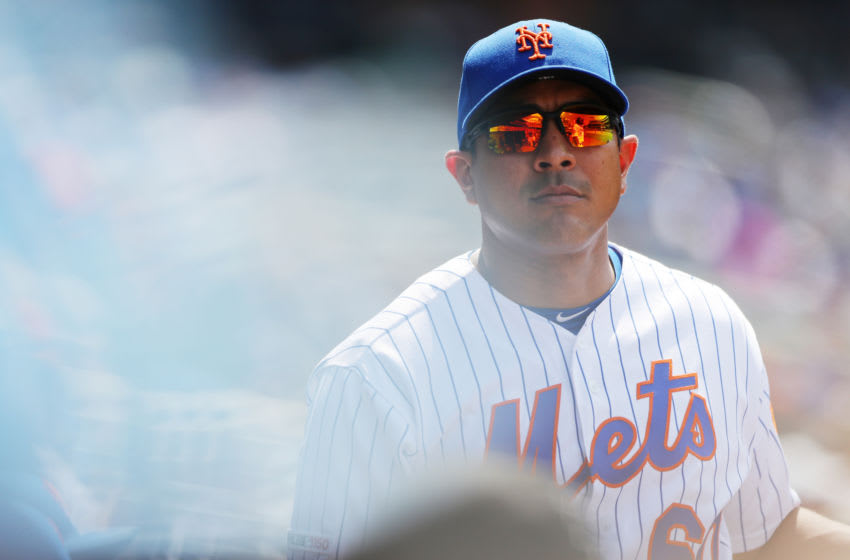 FLUSHING, NY - JULY 25: Quality control coach Luis Rojas looks on from the dugout during the game between the San Diego Padres and the New York Mets at Citi Field on Thursday, July 25, 2019 in Flushing, New York. (Photo by Lizzy Barrett/MLB Photos via Getty Images)