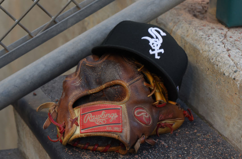 DETROIT, MI - AUGUST 05: A detailed view of a Chicago White Sox baseball hat and a Rawlings glove sitting in the dugout during the game against the Detroit Tigers at Comerica Park on August 5, 2019 in Detroit, Michigan. The White Sox defeated the Tigers 7-4. (Photo by Mark Cunningham/MLB Photos via Getty Images)