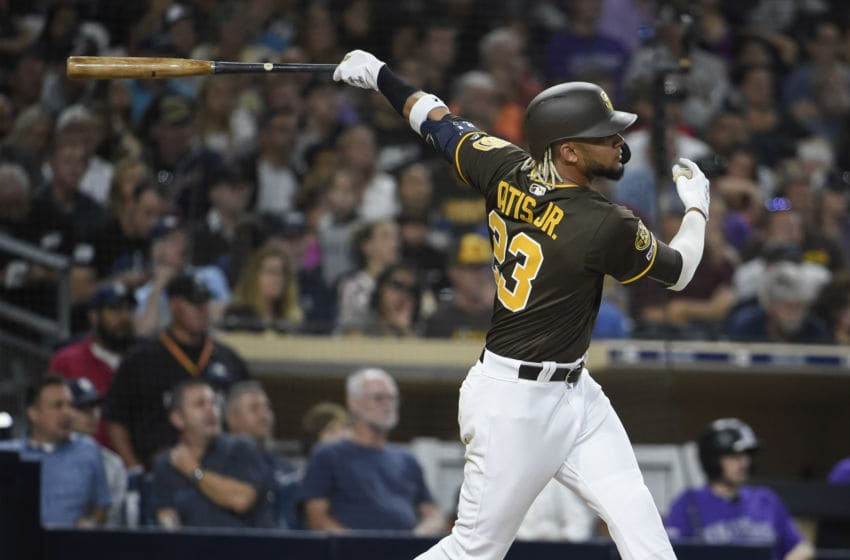 SAN DIEGO, CA - AUGUST 9: Fernando Tatis Jr. #23 of the San Diego Padres hits an RBI double during the third inning of a baseball game against the Colorado Rockies at Petco Park August 9, 2019 in San Diego, California. (Photo by Denis Poroy/Getty Images)
