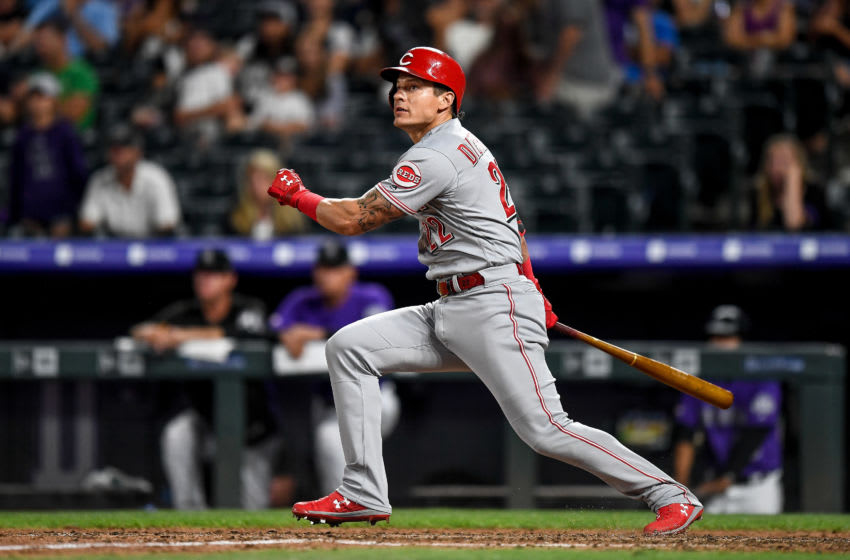 DENVER, CO - JULY 13: Derek Dietrich #22 of the Cincinnati Reds watches the flight of a sixth inning three-run homerun against the Colorado Rockies at Coors Field on July 13, 2019 in Denver, Colorado. (Photo by Dustin Bradford/Getty Images)