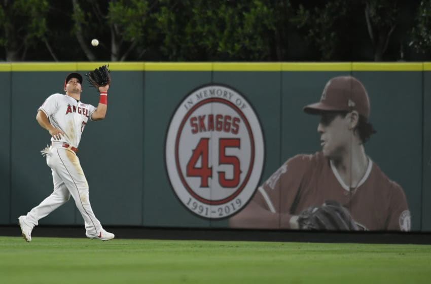 ANAHEIM, CA - AUGUST 30: Mike Trout #27 of the Los Angeles Angels catches a fly ball hit by Sandy Leon #3 of the Boston Red Sox in the first inning in front of a Tyler Skaggs poster on the outfield wall at Angel Stadium of Anaheim on August 30, 2019 in Anaheim, California. (Photo by John McCoy/Getty Images)