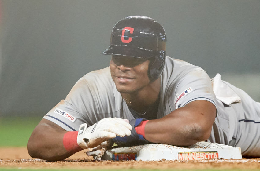 MINNEAPOLIS, MN - AUGUST 09: Yasiel Puig #66 of the Cleveland Indians slides into third base against the Minnesota Twins during the game on August 9, 2019 at Target Field in Minneapolis, Minnesota. The Indians defeated the Twins 6-2. (Photo by Hannah Foslien/Getty Images)