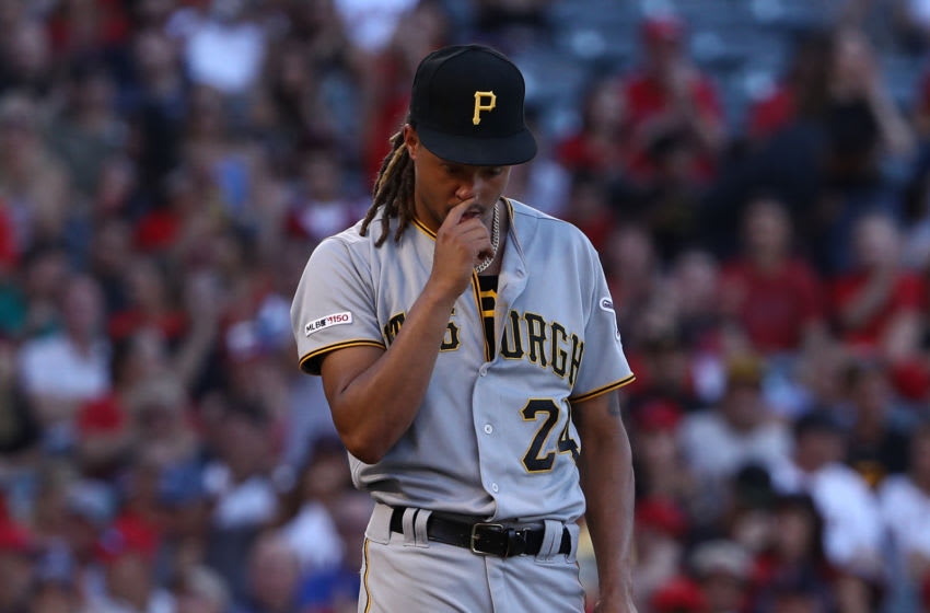ANAHEIM, CALIFORNIA - AUGUST 14: Pitcher Chris Archer #24 of the Pittsburgh Pirates reacts after giving up an rbi single to Albert Pujols #5 of the Los Angeles Angels (not in photo) in the fourth inning of their MLB game at Angel Stadium of Anaheim on August 14, 2019 in Anaheim, California. (Photo by Victor Decolongon/Getty Images)