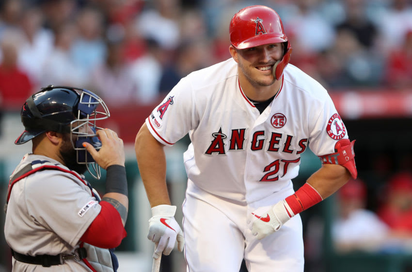 ANAHEIM, CALIFORNIA - AUGUST 31: Mike Trout #27 of the Los Angeles Angels of Anaheim talks with Sandy Leon #3 of the Boston Red Sox during an at bat of a game at Angel Stadium of Anaheim on August 31, 2019 in Anaheim, California. (Photo by Sean M. Haffey/Getty Images)