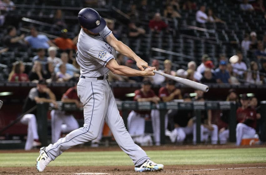 PHOENIX, ARIZONA - SEPTEMBER 04: Wil Myers #4 of the San Diego Padres hits a solo home run in the ninth inning of the MLB game against the Arizona Diamondbacks at Chase Field on September 04, 2019 in Phoenix, Arizona. (Photo by Jennifer Stewart/Getty Images)