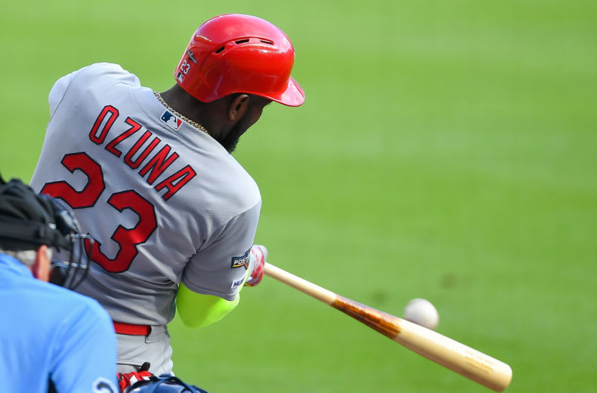 ATLANTA, GA OCTOBER 09: St. Louis Cardinals left fielder Marcell Ozuna (23) singles during the National League Division Series game 5 between the St. Louis Cardinals and the Atlanta Braves on October 9th, 2019 at SunTrust Park in Atlanta, GA. (Photo by Rich von Biberstein/Icon Sportswire via Getty Images)