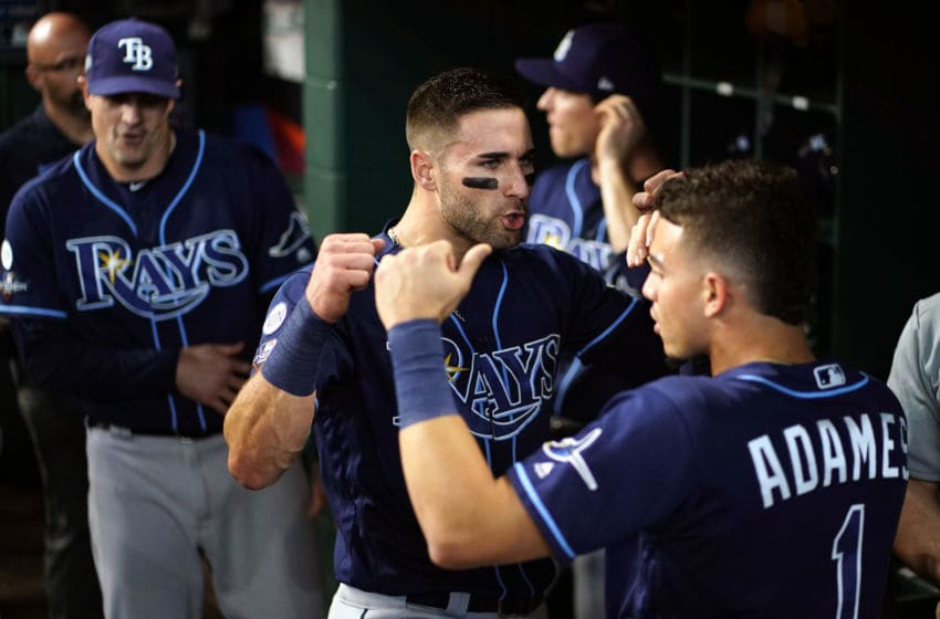 HOUSTON, TX - OCTOBER 10: Kevin Kiermaier #39 and Willy Adames #1 of the Tampa Bay Rays get ready in the dugout before Game 5 of the ALDS between the Tampa Bay Rays and the Houston Astros at Minute Maid Park on Thursday, October 10, 2019 in Houston, Texas. (Photo by Cooper Neill/MLB Photos via Getty Images)