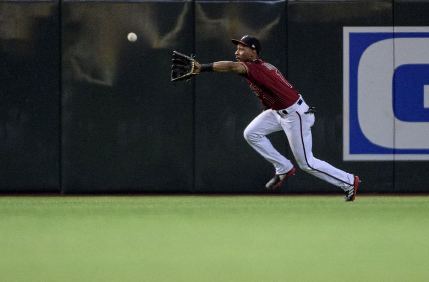 PHOENIX, ARIZONA - SEPTEMBER 18: Jarrod Dyson #1 of the Arizona Diamondbacks catches a fly ball sixth inning of the MLB game against the Miami Marlins at Chase Field on September 18, 2019 in Phoenix, Arizona. (Photo by Jennifer Stewart/Getty Images)