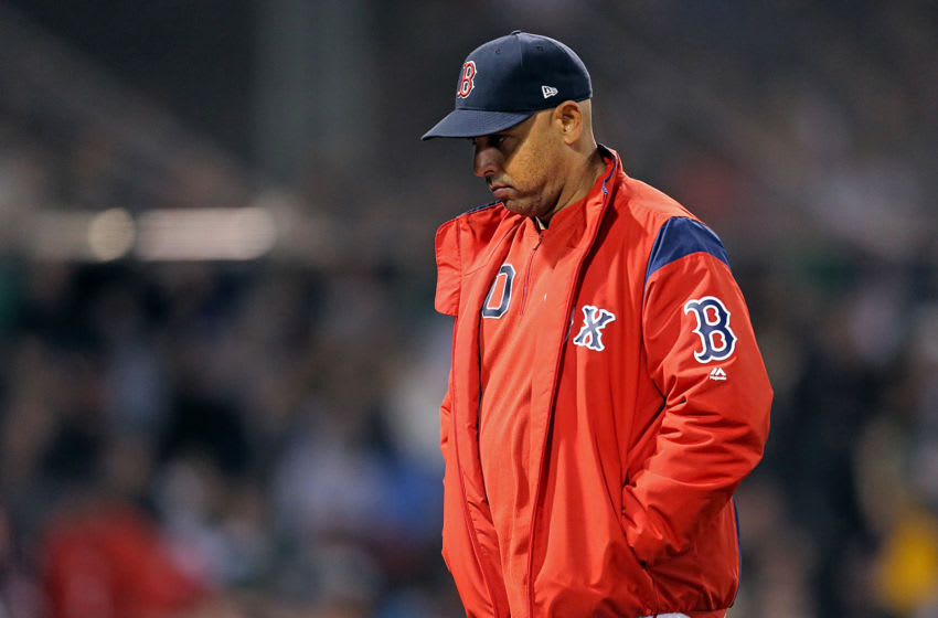 BOSTON, MA. - SEPTEMBER 18: Alex Cora #20 of the Boston Red Sox walks back to the dugout after visiting the mound during the fifth inning of the MLB game against the San Francisco Giants at Fenway Park on September 18, 2019 in Boston, Massachusetts. (Staff Photo By Matt Stone/MediaNews Group/Boston Herald)