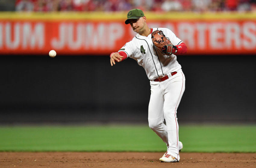 CINCINNATI, OH - SEPTEMBER 20: Jose Iglesias #4 of the Cincinnati Reds throws to first base against the New York Mets at Great American Ball Park on September 20, 2019 in Cincinnati, Ohio. (Photo by Jamie Sabau/Getty Images)