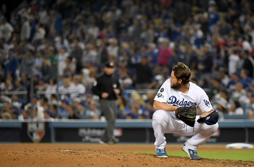 LOS ANGELES, CALIFORNIA - OCTOBER 09: Clayton Kershaw #22 of the Los Angeles Dodgers reacts after giving up a solo home run to Juan Soto #22 of the Washington Nationals in the eighth inning of game five of the National League Division Series, to tie the game 3-3, at Dodger Stadium on October 09, 2019 in Los Angeles, California. (Photo by Harry How/Getty Images)