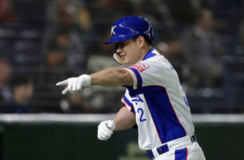 TOKYO, JAPAN - NOVEMBER 11: Designated hitter Kim Jaehwan #32 of South Korea celebrates hitting a three-run homer in the bottom of 1st inning during the WBSC Premier 12 Super Round game between South Korea and USA at the Tokyo Dome on November 11, 2019 in Tokyo, Japan. (Photo by Kiyoshi Ota/Getty Images)