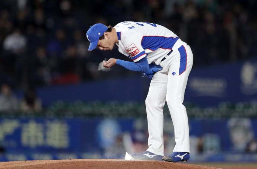 CHIBA, JAPAN - NOVEMBER 12: Pitcher Kim Kwanghyun #29 of South Korea prepares for pitch in the top of 1st inning during the WBSC Premier 12 Super Round game between South Korea and Chinese Taipei at the Zozo Marine Stadium on November 12, 2019 in Chiba, Japan. (Photo by Kiyoshi Ota/Getty Images)