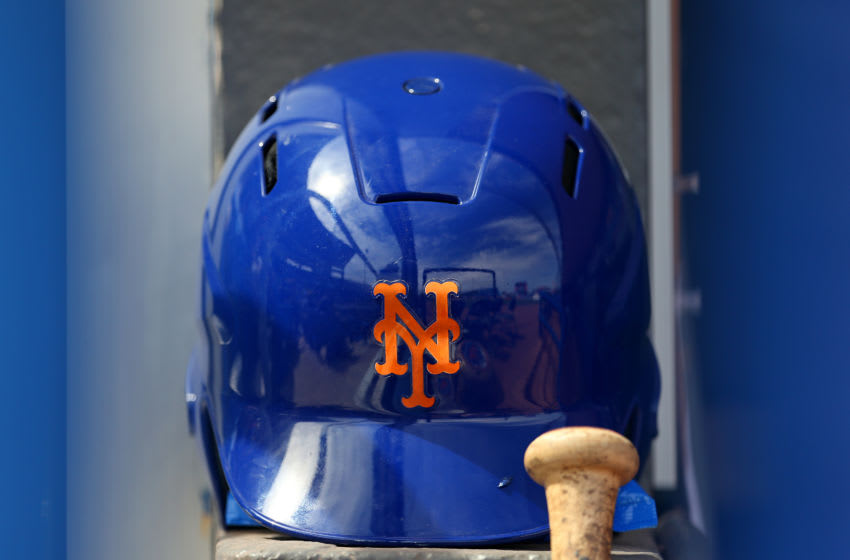 PORT ST. LUCIE, FL - MARCH 08: A New York Mets batting helmet in the dugout before a spring training baseball game against the Houston Astros at Clover Park on March 8, 2020 in Port St. Lucie, Florida. The Mets defeated the Astros 3-1. (Photo by Rich Schultz/Getty Images)