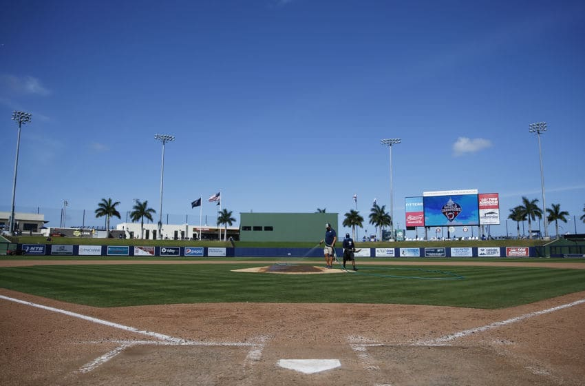 VARIOUS CITIES, - MARCH 12: Grounds crew workers clean up the field after the Grapefruit League spring training game between the Washington Nationals and the New York Yankees at FITTEAM Ballpark of The Palm Beaches on March 12, 2020 in West Palm Beach, Florida. The MLB suspended the remaining spring training games due to the ongoing threat of the Coronavirus (COVID-19) outbreak. (Photo by Michael Reaves/Getty Images)