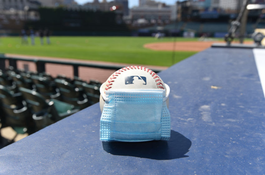 DETROIT, MI - JULY 05: A detailed view of an official Major League Baseball with a surgical mask placed on it sitting on the dugout during the Detroit Tigers Summer Workouts at Comerica Park on July 5, 2020 in Detroit, Michigan. (Photo by Mark Cunningham/MLB Photos via Getty Images)