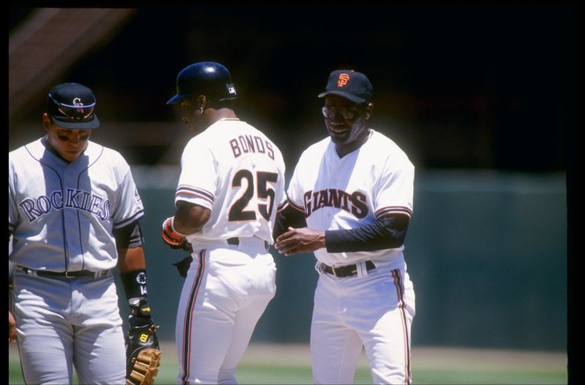 24 Jun 1993: Left fielder Barry Bonds and coach Bobby Bonds of the San Francisco Giants speak to each other during a game against the Colorado Rockies at Candlestick Park in San Francisco, California. Mandatory Credit: Otto Greule /Allsport
