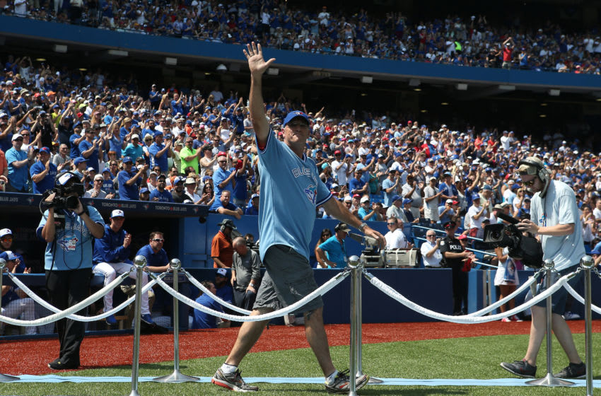 TORONTO, CANADA - AUGUST 16: Former player Tom Henke #50 of the Toronto Blue Jays acknowledges the fansâ ovation during a ceremony commemorating the 30th anniversary of the Blue Jaysâ first division title before the start of MLB game action against the New York Yankees on August 16, 2015 at Rogers Centre in Toronto, Ontario, Canada. (Photo by Tom Szczerbowski/Getty Images)