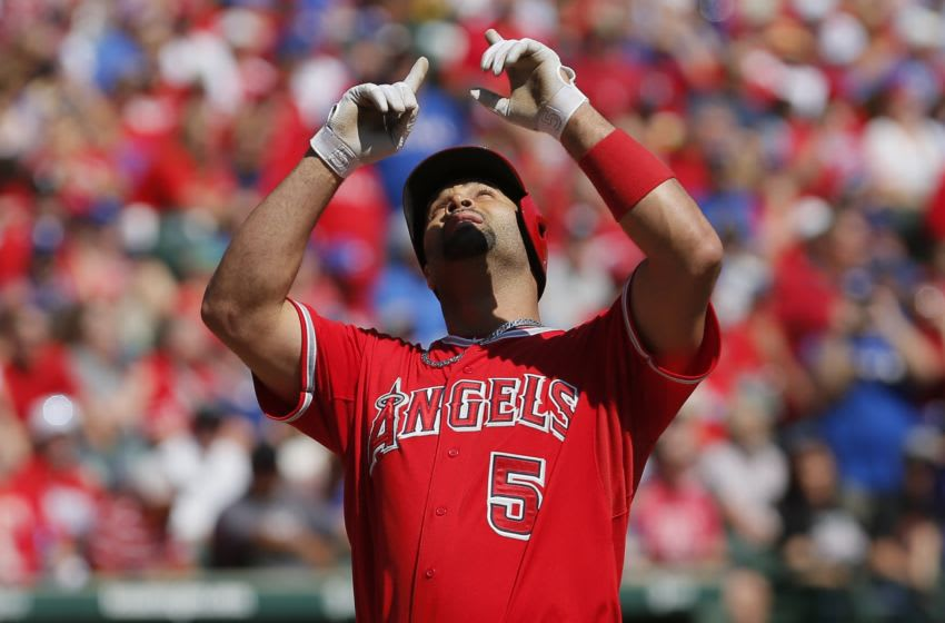 ARLINGTON, TX - OCTOBER 4: Albert Pujols #5 of the Los Angeles Angels celebrates hitting a two-run home run during the first inning of a baseball game against the Texas Rangers at Globe Life Park on October 4, 2015 in Arlington, Texas. (Photo by Brandon Wade/Getty Images)