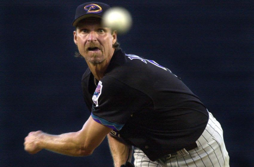 LOS ANGELES, UNITED STATES: Randy Johnson of the Arizona Diamondbacks throws to the plate against the Los Angeles Dodgers, 19 June 2001, in Los Angeles, CA. Johnson recorded his ninth victory of the season as the Diamondbacks won the game, 9-2. AFP PHOTO/VINCE BUCCI (Photo credit should read Vince Bucci/AFP via Getty Images)