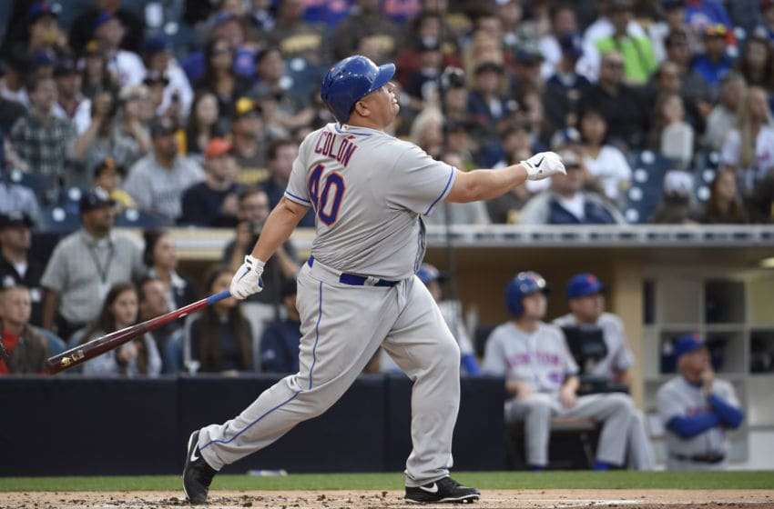 SAN DIEGO, CALIFORNIA - MAY 7: Bartolo Colon #40 of the New York Mets hits a two-home run during the second inning of a baseball game against the San Diego Padres at PETCO Park on May 7, 2016 in San Diego, California. (Photo by Denis Poroy/Getty Images)