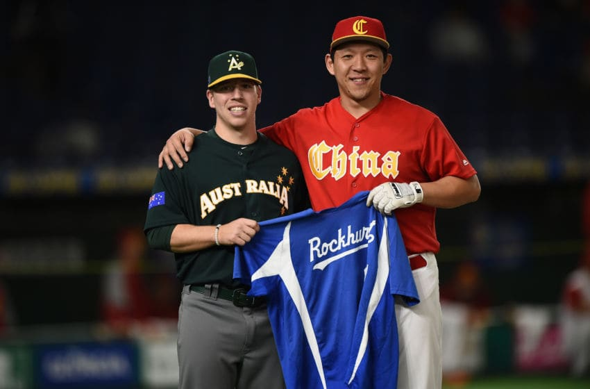 TOKYO, JAPAN - MARCH 09: Pitcher Josh Tols #13 of Australia and Infielder Ray Chang #21 of China pose for photographs prior to the World Baseball Classic Pool B Game Four between Australia and China at the Tokyo Dome on March 9, 2017 in Tokyo, Japan. (Photo by Matt Roberts/Getty Images)