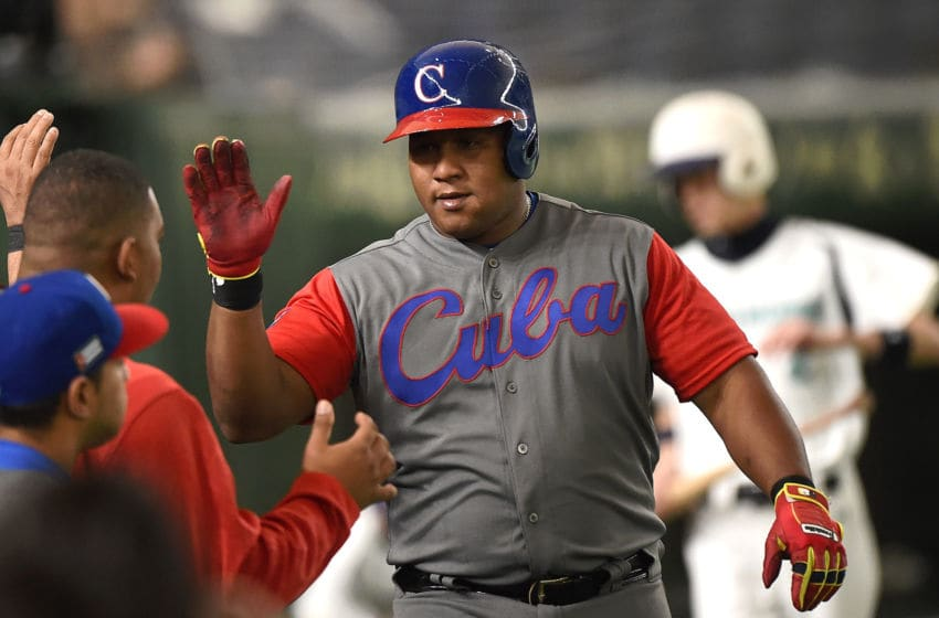 TOKYO, JAPAN - MARCH 12: Alfredo Despaigne #54 of Cuba celebrates after hitting a homer on a line drive to left center field in the second inning during the World Baseball Classic Pool E Game One between Cuba and Israel at Tokyo Dome on March 12, 2017 in Tokyo, Japan. (Photo by Matt Roberts/Getty Images)