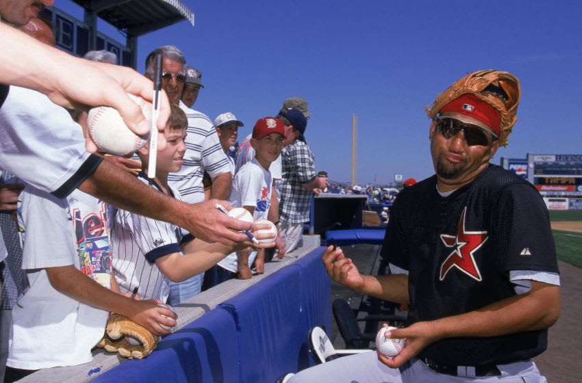 5 Mar 2000: Jose Lima #42 of the Houston Astros signs autographs before the Spring Training Game against the New York Yankees in Tampa Bay, Florida.