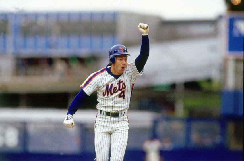 FLUSHING, NY - AUGUST 1986: Lenny Dykstra #4 of the New York Mets celebrates after hitting a home run in August 1986 in Shea Stadium in Flushing, New York. (Photo by Ronald C. Modra/Getty Images)