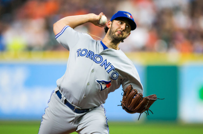 HOUSTON, TX - AUGUST 04: Toronto Blue Jays starting pitcher Mike Bolsinger (49) delivers the pitch in the fourth inning of a MLB game between the Houston Astros and the Toronto Blue Jays at Minute Maid Park, Friday, August 4, 2017. Houston Astros defeated Toronto Blue Jays 16-7. (Photo by Juan DeLeon/Icon Sportswire via Getty Images)