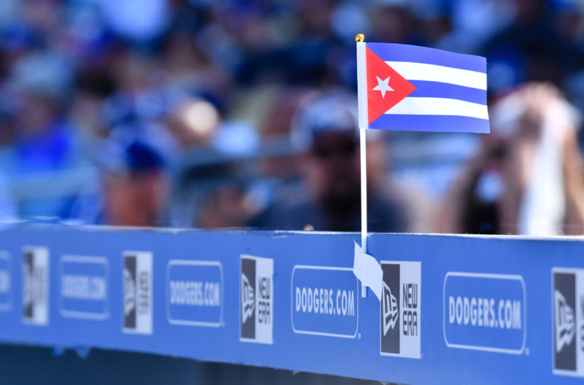 LOS ANGELES, CA - AUGUST 27: A small Cuba flag flies on top of the Dodger dugout during an MLB game between the Milwaukee Brewers and the Los Angeles Dodgers on August 27 2017 at Dodger Stadium in Los Angeles, CA. (Photo by Brian Rothmuller/Icon Sportswire via Getty Images)
