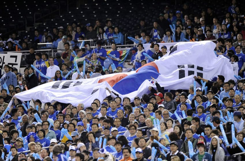 SAN DIEGO - MARCH 17: A Korean flag gets passed down through the stands as Korea plays against Japan during the 2009 World Baseball Classic Round 2 Pool 1 Game 4 on March 17, 2009 at Petco Park in San Diego, California. (Photo by Kevork Djansezian/Getty Images)