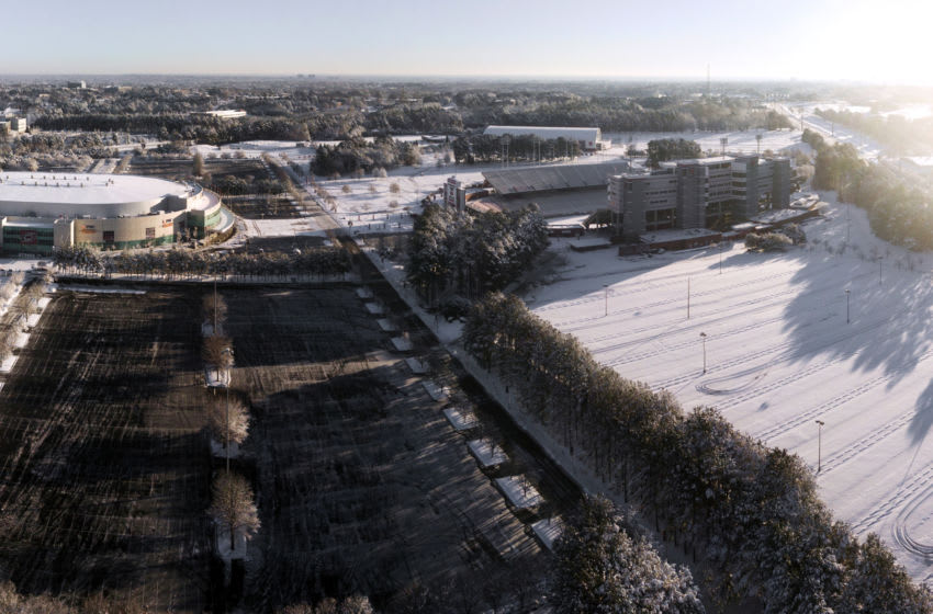 RALEIGH, NC - JANUARY 18: (EDITORS NOTE: Image is a digital panoramic composite.) An aerial view of PNC Arena (L), Carter-Finley Stadium (R) and the surrounding area following a snow storm on January 18, 2018 in Raleigh, North Carolina. (Photo by Lance King/Getty Images)