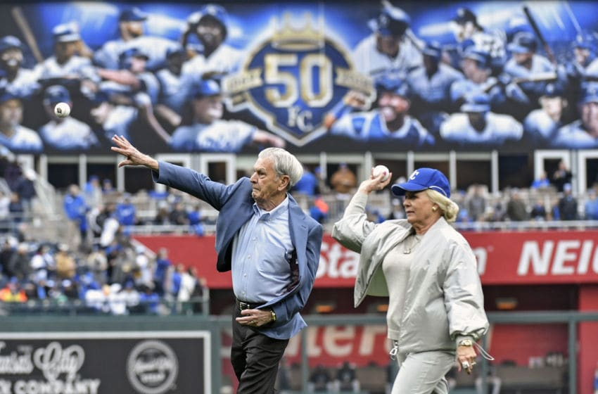 Kansas City Royals owner David Glass and Julian Irene Kauffman throw out the first pitches before Thursday's baseball game against the Chicago White Sox, on March 29, 2018, at Kauffman Stadium in Kansas City, Mo. (John Sleezer/Kansas City Star/Tribune News Service via Getty Images)