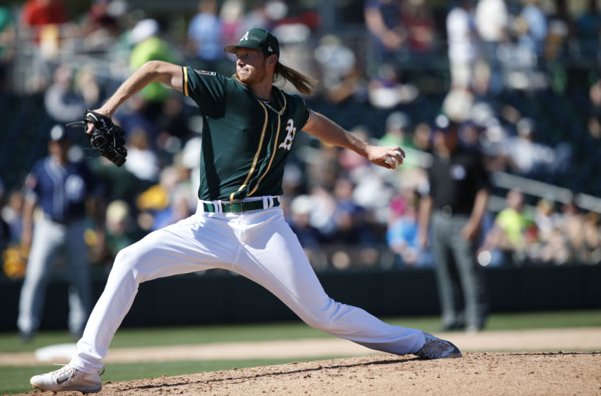 MESA, AZ - MARCH 3: A.J. Puk #30 of the Oakland Athletics pitches during the game against the San Diego Padres at Hohokam Stadium on March 3, 2018 in Mesa, Arizona. (Photo by Michael Zagaris/Oakland Athletics/Getty Images) *** Local Caption *** A.J. Puk