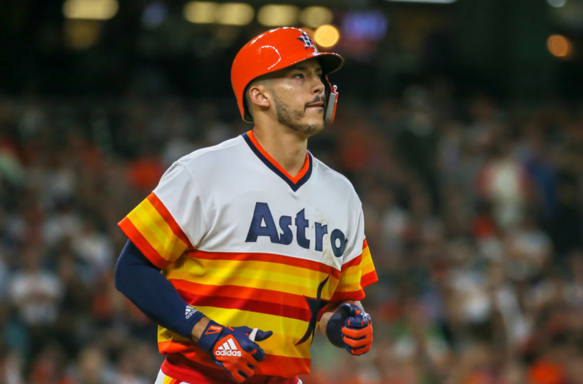 HOUSTON, TX - AUGUST 10: Houston Astros shortstop Carlos Correa (1) gets a walk in the bottom of the first inning during the baseball game between the Seattle Mariners and Houston Astros on August 10, 2018 at Minute Maid Park in Houston, Texas. (Photo by Leslie Plaza Johnson/Icon Sportswire via Getty Images)