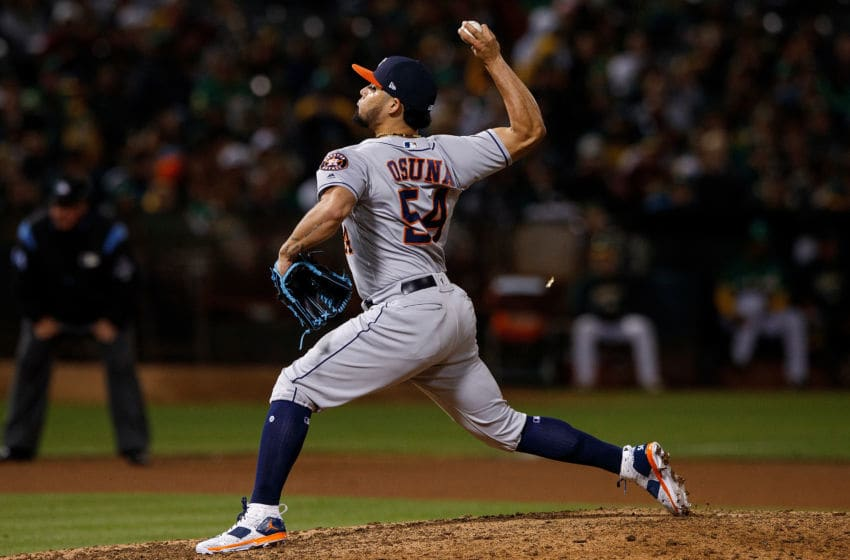 OAKLAND, CA - AUGUST 17: Roberto Osuna #54 of the Houston Astros pitches against the Oakland Athletics during the eighth inning at the Oakland Coliseum on August 17, 2018 in Oakland, California. The Oakland Athletics defeated the Houston Astros 4-3 in 10 innings. (Photo by Jason O. Watson/Getty Images)