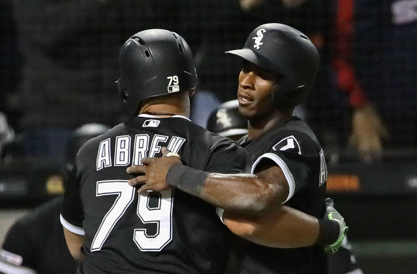CHICAGO, ILLINOIS - APRIL 26: Tim Anderson #7 of the Chicago White Sox hugs Jose Abreu #79 after Abreu hit a two run home run in the 6th inning against the Detroit Tigers at Guaranteed Rate Field on April 26, 2019 in Chicago, Illinois. (Photo by Jonathan Daniel/Getty Images)