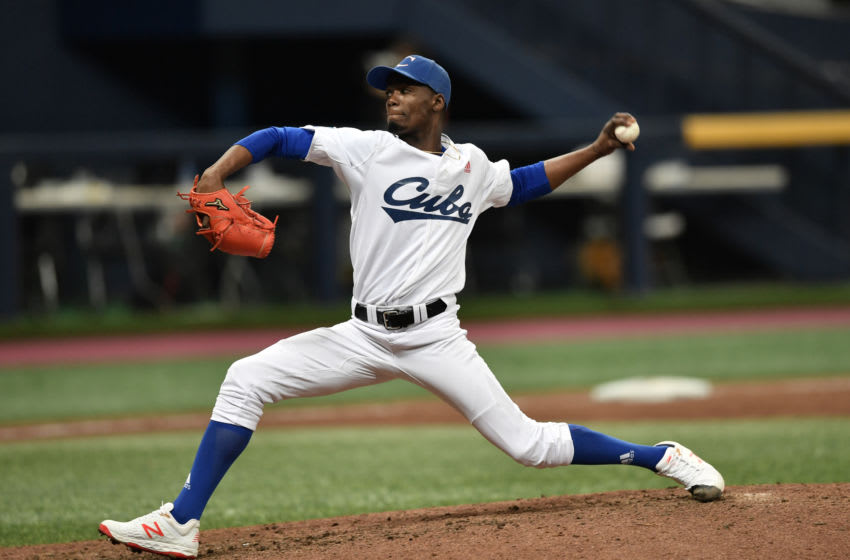 Pitcher Livan Moinelo of Cuba pitches against Australia in the tenth inning during the WBSC Premier 12 Opening Round group C baseball game between Cuba and Australia at Gocheok Sky Dome in Seoul on November 7, 2019. (Photo by Jung Yeon-je / AFP) (Photo by JUNG YEON-JE/AFP via Getty Images)