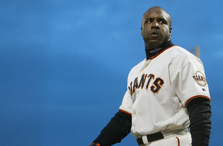 San Francisco Giants slugger Barry Bonds walks to the dugout after he was brought home on a sacifice fly by Reggie Sanders against the Anaheim Angels in the second inning of Game Five in the World Series in San Francisco 24 October, 2002. AFP PHOTO Timothy A. CLARY (Photo by Timothy A. CLARY / AFP) (Photo by TIMOTHY A. CLARY/AFP via Getty Images)