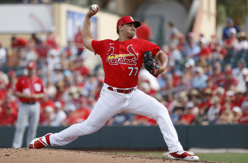 JUPITER, FL - FEBRUARY 25: Roel Ramirez #77 of the St Louis Cardinals pitches during a Grapefruit League spring training game against the Washington Nationals at Roger Dean Stadium on February 25, 2020 in Jupiter, Florida. The Nationals defeated the Cardinals 9-6. (Photo by Joe Robbins/Getty Images)