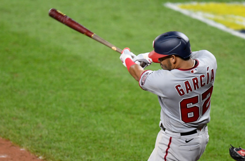 BALTIMORE, MD - AUGUST 14: Luis Garcia #62 of the Washington Nationals drives in two runs with a double in the eighth inning during his MLB debut against the Baltimore Orioles at Oriole Park at Camden Yards on August 14, 2020 in Baltimore, Maryland. (Photo by Greg Fiume/Getty Images)