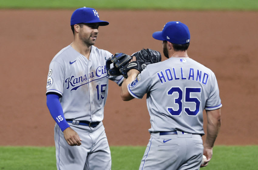 CLEVELAND, OH - SEPTEMBER 09: Whit Merrifield #15 and Greg Holland #35 of the Kansas City Royals celebrate a 3-0 victory over the Cleveland Indians at Progressive Field on September 09, 2020 in Cleveland, Ohio. (Photo by Ron Schwane/Getty Images)
