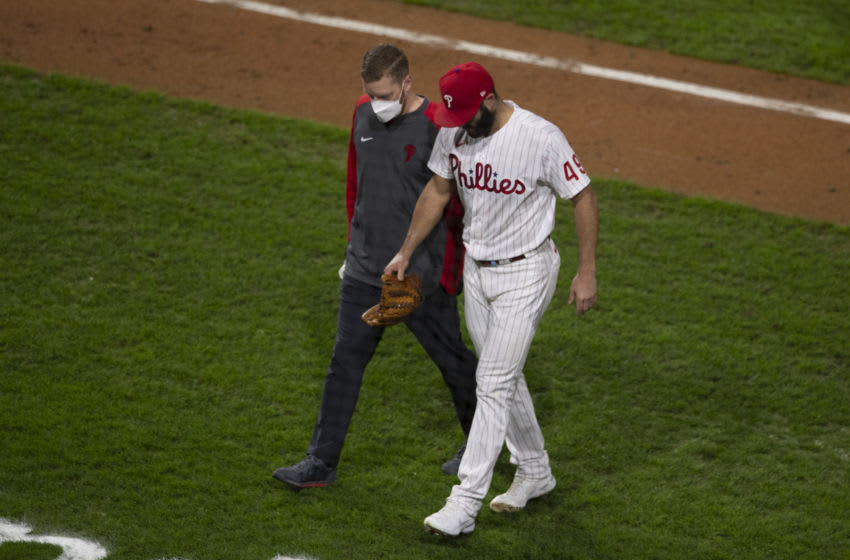 PHILADELPHIA, PA - SEPTEMBER 15: Jake Arrieta #49 of the Philadelphia Phillies walks off the field with trainer Aaron Hoback after sustaining an injury in the top of the sixth inning against the New York Mets at Citizens Bank Park on September 15, 2020 in Philadelphia, Pennsylvania. The Phillies defeated the Mets 4-1. (Photo by Mitchell Leff/Getty Images)