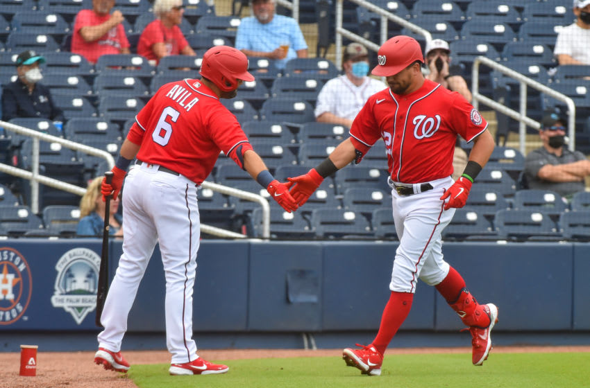 WEST PALM BEACH, FL - MARCH 03: Kyle Schwarber #12 of the Washington Nationals is congratulated by Alex Avila #6 after hitting a home run during the second inning of the spring training game against the Miami Marlins at The Ballpark of The Palm Beaches on March 3, 2021 in West Palm Beach, Florida. (Photo by Eric Espada/Getty Images)