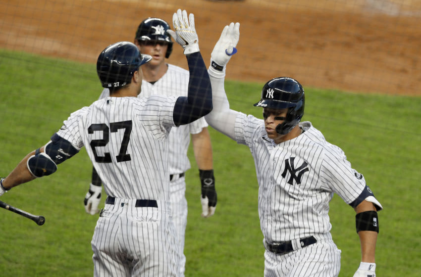NEW YORK, NEW YORK - JULY 31: (NEW YORK DAILIES OUT) Aaron Judge #99 of the New York Yankees celebrates his third inning two run home run against the Boston Red Sox with teammate Giancarlo Stanton #27 at Yankee Stadium on July 31, 2020 in New York City. The Yankees defeated the Red Sox 5-1. (Photo by Jim McIsaac/Getty Images)